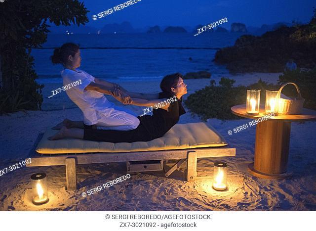 Doing a thai massage in the beach of Six Senses Resort, Koh Yao Noi, Phang Nga Bay, Thailand, Asia. Six Senses Yao Noi sets the highest benchmark for island...