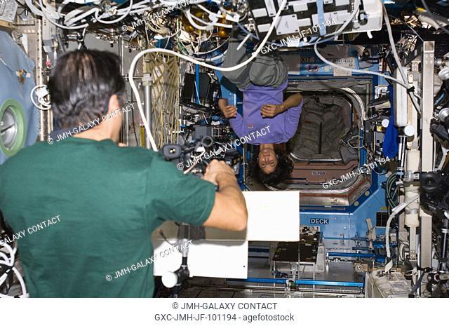 NASA astronauts Joe Acaba and Sunita Williams, both Expedition 32 flight engineers, perform video message recording in the Destiny laboratory of the...