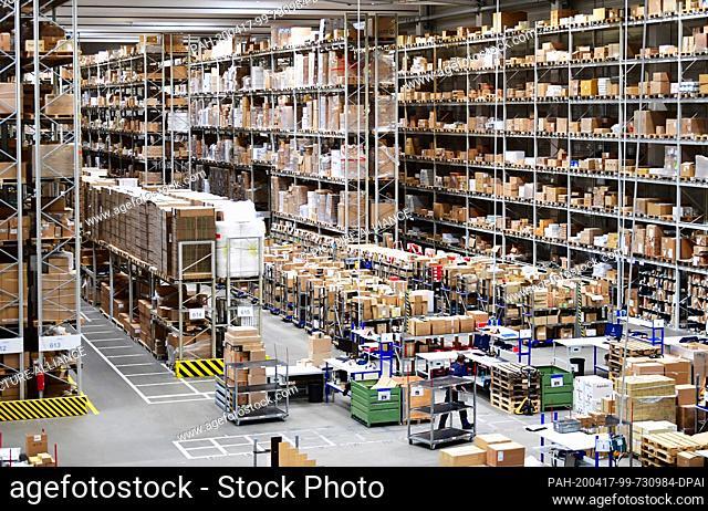 16 April 2020, Brandenburg, Großbeeren: High shelves and packing tables at the logistics service provider Rhenus Warehousing Solutions SE & Co. KG