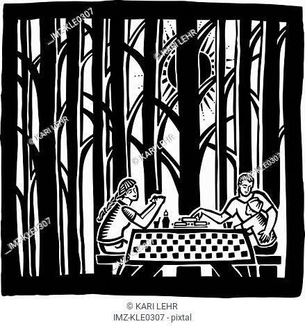 A family having a picnic in the woods