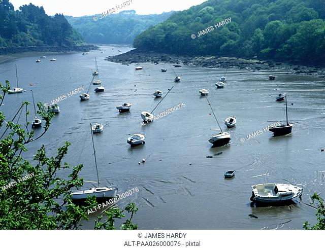 France, Brittany, small fishing boats on river bottom