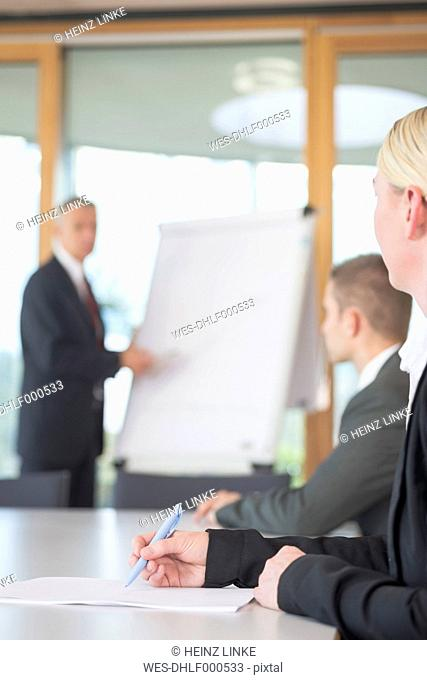 Three business people in a workshop