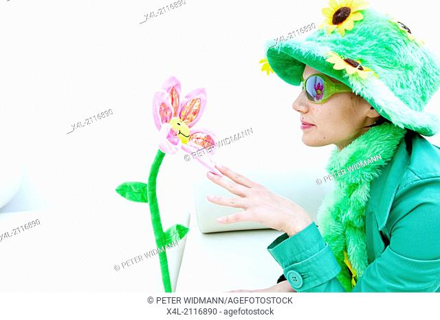 Young woman with textile flowers, flower power (model-released)