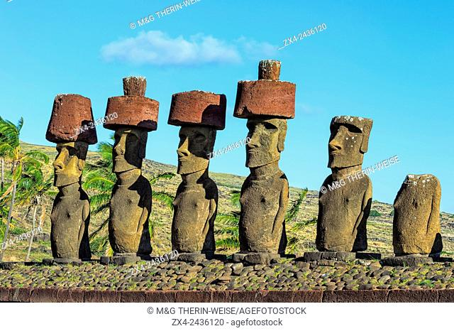Ahu Nao-Nao Moais wearing a red hat, Anakena, Rapa Nui National Park, Easter Island, Chile, Unesco World Heritage Site
