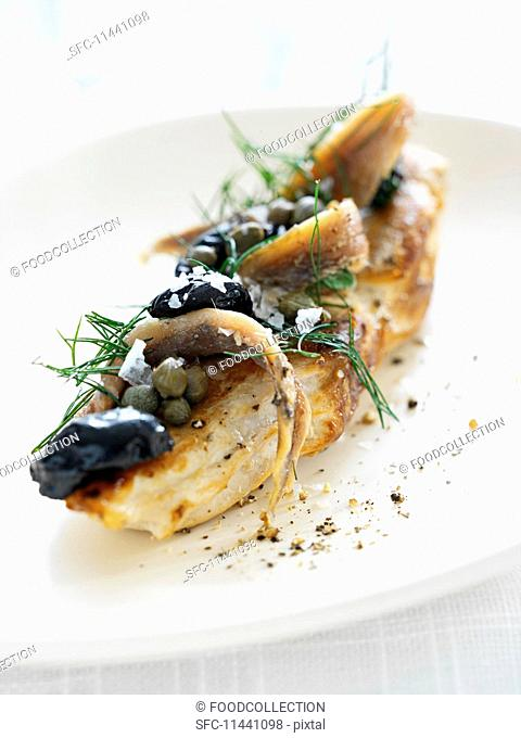 Chicken breast with anchovies, capers and dill