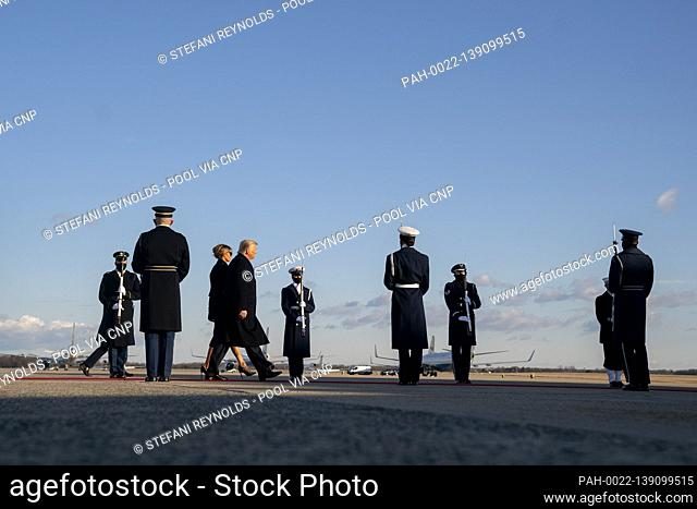 U.S. President Donald Trump and U.S. First Lady Melania Trump walk to board Air Force One during a farewell ceremony at Joint Base Andrews, Maryland, U