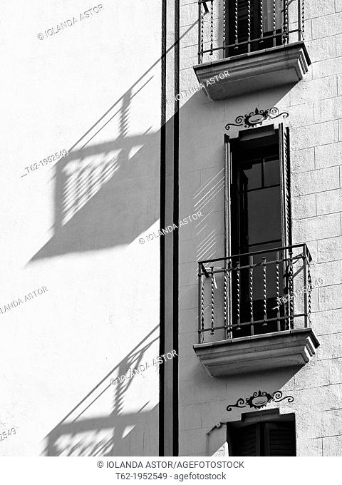 Balconies and shadows of a manor house in the Gracia district of Barcelona