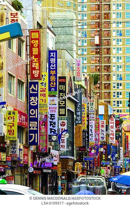 Signs in shopping area with words in Korean Busan Pusan South Korea Asia