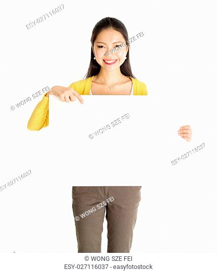 Portrait of casual Asian female hand holding blank white paper card and pointing on it, isolated on white background
