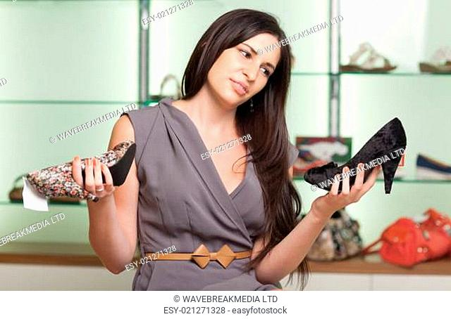 Woman choosing shoes and smiling