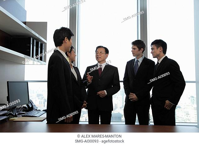 A small group of business people talking together