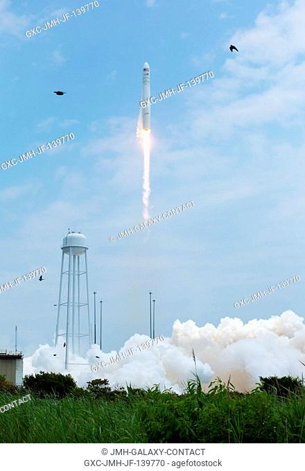 The Orbital Sciences Corporation Antares rocket launches from Pad-0A with the Cygnus spacecraft onboard, July 13, 2014, at NASA's Wallops Flight Facility in...
