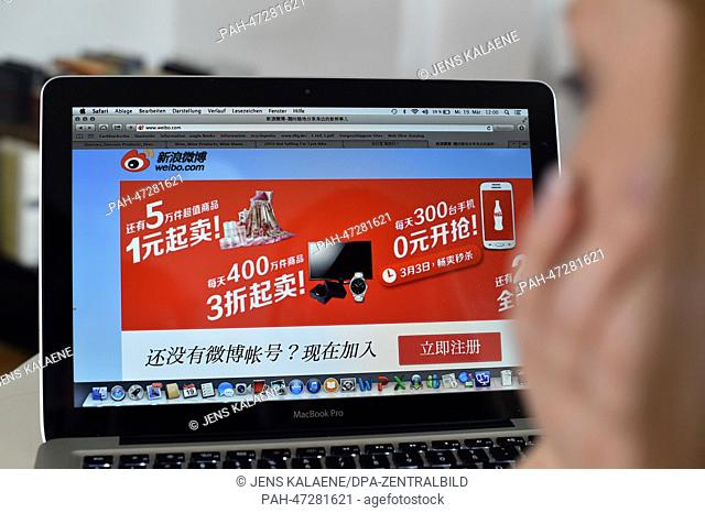 ILLUSTRATION - A young woman browses on her notebook computer through the web page of Chinese online social networking and microblogging service Weibo in Berlin