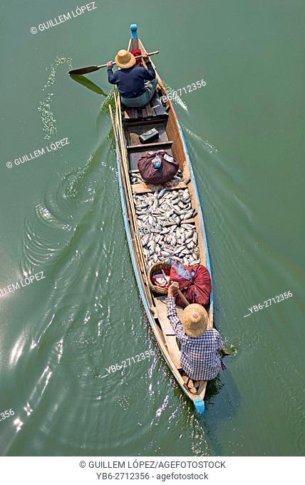 Fishermen in their boat viewed from above at the Taungthaman Lake, Amarapura, Myanmar