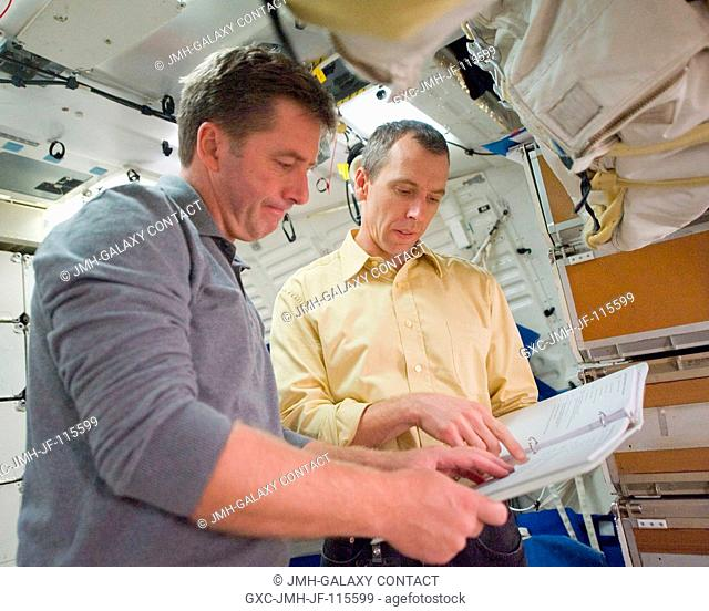 European Space Agency astronaut Roberto Vittori (left) and NASA astronaut Andrew Feustel, both STS-134 mission specialists