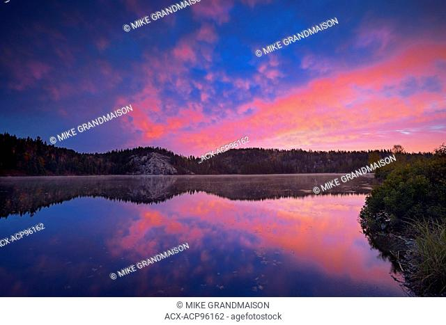A dawn sky reflected in the the Vermilion RIver Capreol Ontario Canada