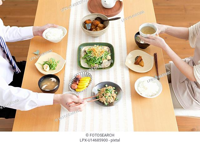 High Angle View of Couple Having Breakfast