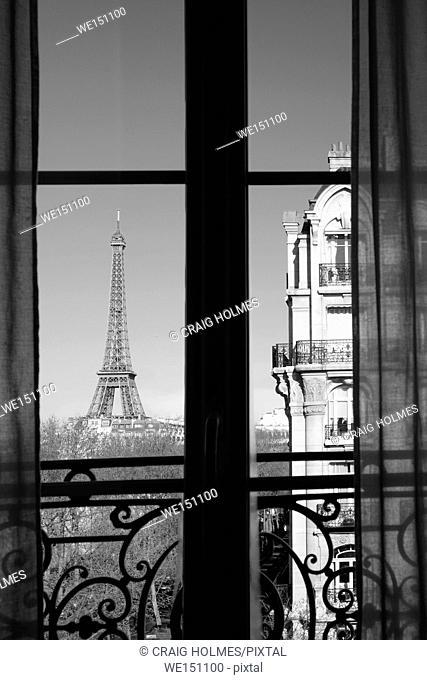 The Eiffel Tower, Paris, France, as seen through a window