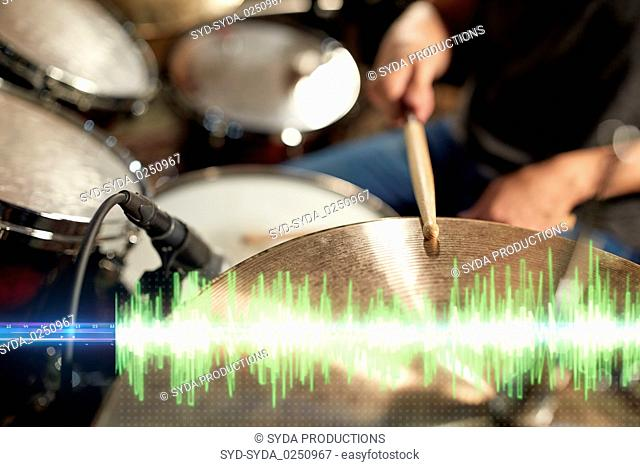 drummer playing drum kit at sound recording studio