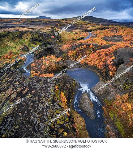 From above lava and moss landscape in the autumn, Gjaarfoss in the Thjorsardalur valley, Iceland. This image is shot with a drone