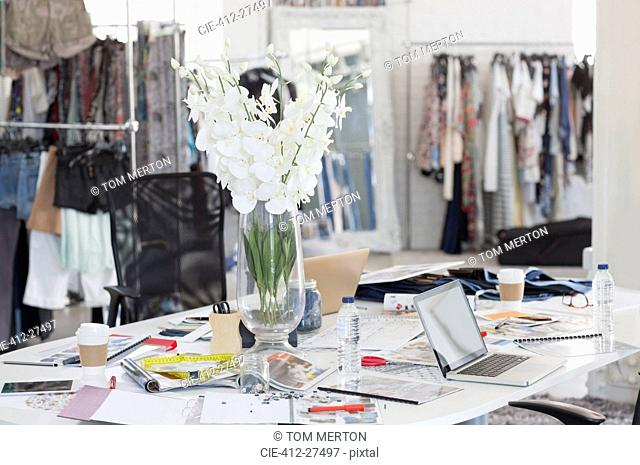Bouquet, proofs, swatches and clothing in fashion design office