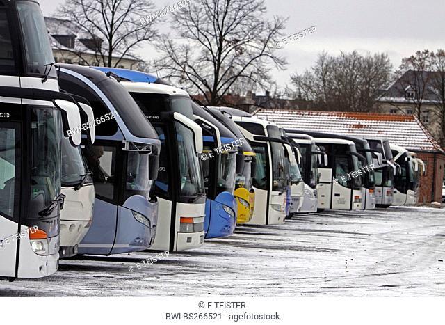 tour buses on a parking place, Germany, North Rhine-Westphalia, Muensterland, Muensterland