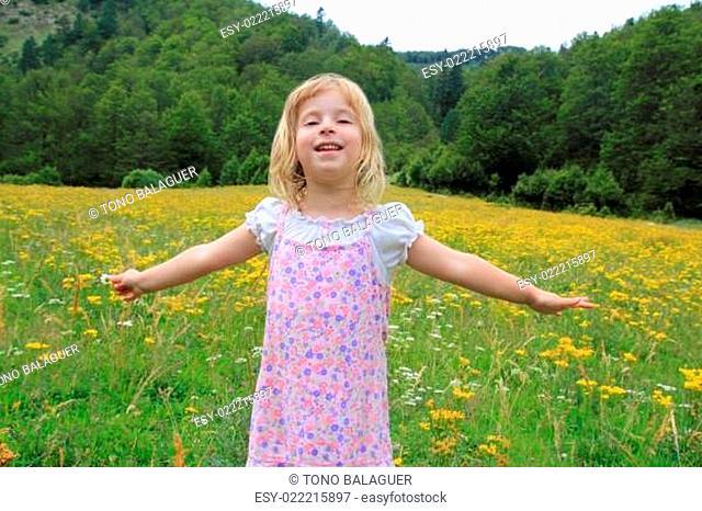 Open arms girl in beautiful flower spring meadow