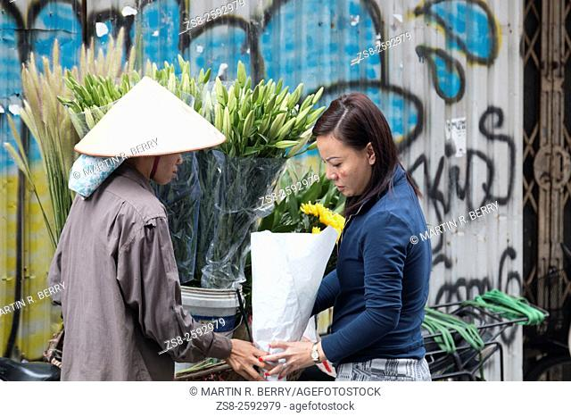Street Scene with Flower Seller in Hanoi Old Quarter, Vietnam, Asia