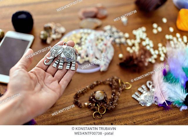 Woman holding elephant figurine for handicraft