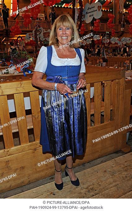 23 September 2019, Bavaria, Munich: Elke Reichert, wife of surgeon Bruno Reichert, is a guest at the traditional Regine Sixt Damenwiesn in the Schützen-Festzelt...