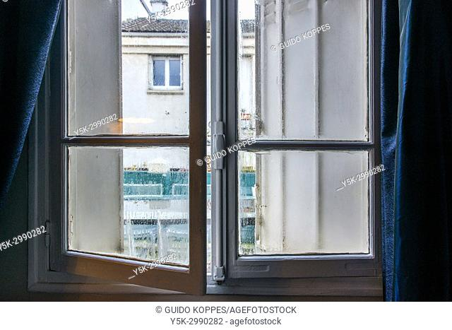 Paris, France. Outlook from an Airbnb bedroom window to opposite residential buildings. A nice neighborhood is one of the unique selling point of many rooms and...