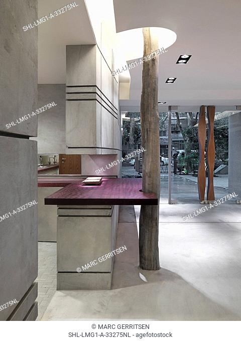 Modern entrance hall with cement walls and floor
