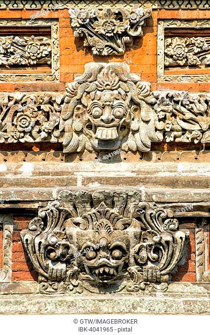 Pura Taman Ayun Temple, sculptures of the Bale basement, wood pavilion, Mengwi, Bali, Indonesia