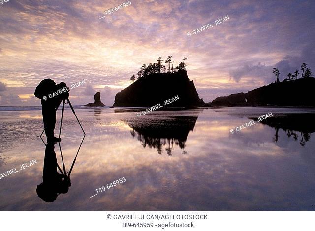 Photographer reflection on the seashore