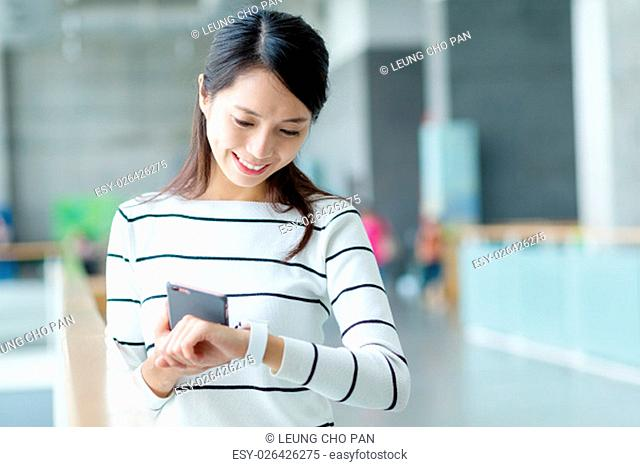 Woman connecting for cellphone and smart watch