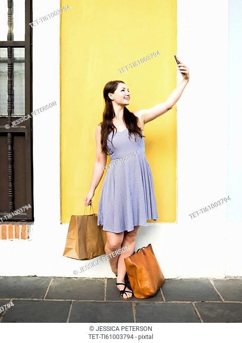 Puerto Rico, San Juan, Woman taking selfie during shopping