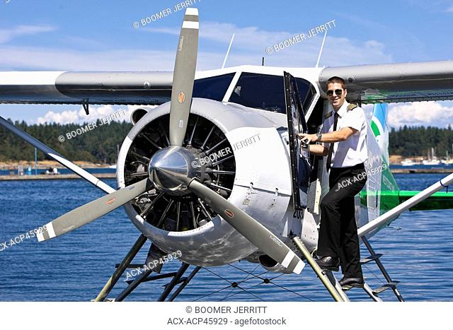 A pilot with his Beaver aircraft, about to takeoff out of Nanaimo's inner harbour on a scheduled flight with Harbour Air