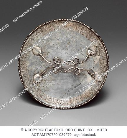 Silver mirror, Imperial, 4th century A.D., Roman, Silver, Diam.: 5 3/16 in. (13.2 cm), Gold and Silver, The type of mirror with a horizontal handle originated...