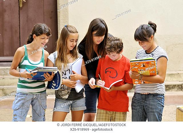 group of students taking a lesson outside the historic building