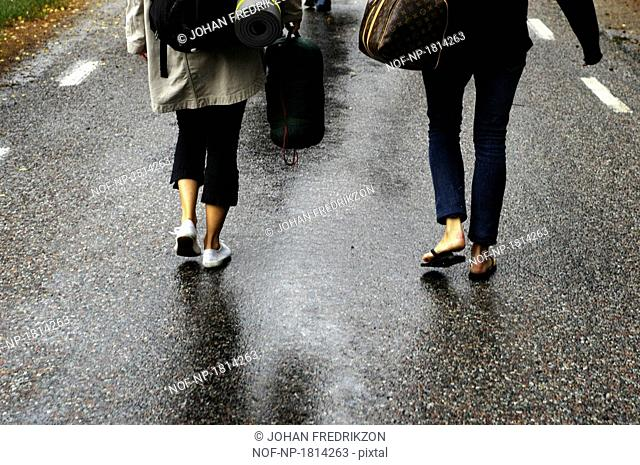 Low section view of two girls walking on a road