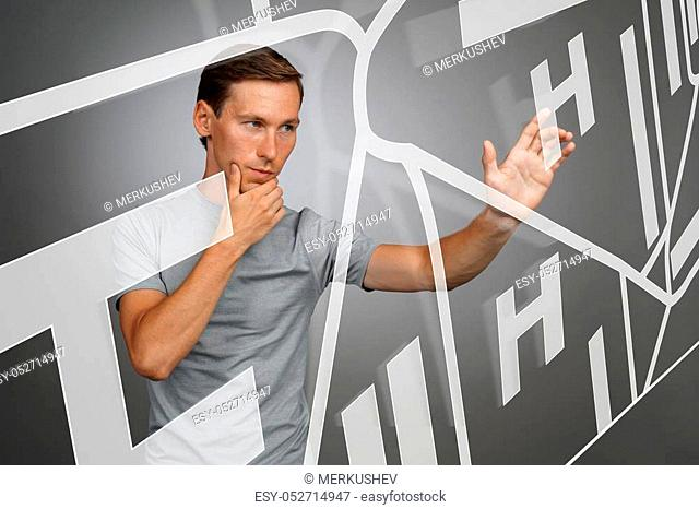 Future technology, navigation, location concept. Man showing transparent screen with gps navigator map. Grey background