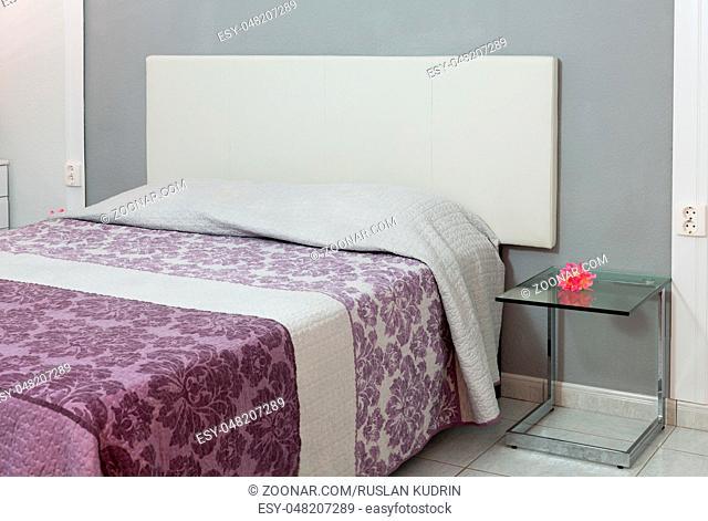 Interior bedroom home in violet tones. Horizontal shot