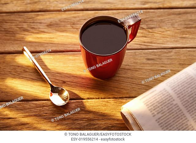 Coffee red cup newspaper morning breakfast on vintage wooden table