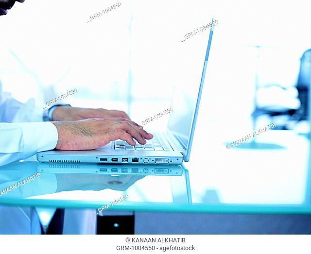 Arab businessman working on laptop