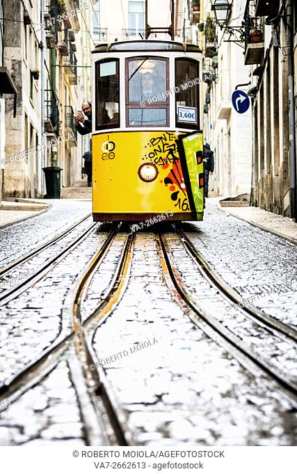 The characteristic yellow tram proceed towards Bairro Alto a central district of the old city of Lisbon Portugal Europe