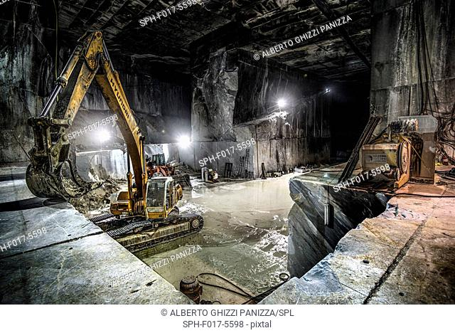 Heavy machinery inside marble quarries of Carrara, Italy