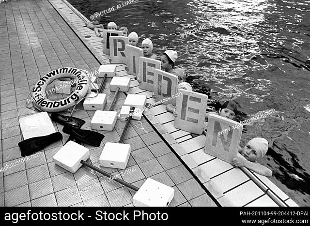 """30 November 1983, Saxony, Eilenburg: The word """"""""peace"""""""" is written on swimming aids that show children in the Eilenburg swimming hall"""