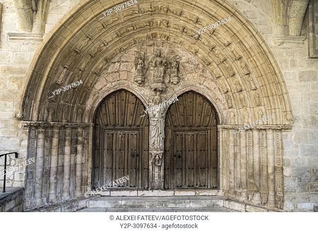 Romanesque to Gothic transition style portal (13th century) of the church San Juan in Oña, Castile and Leon, Spain