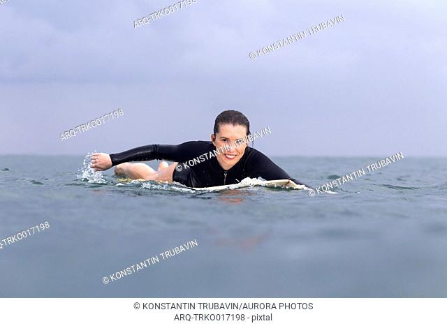 Surfer paddling on the sea