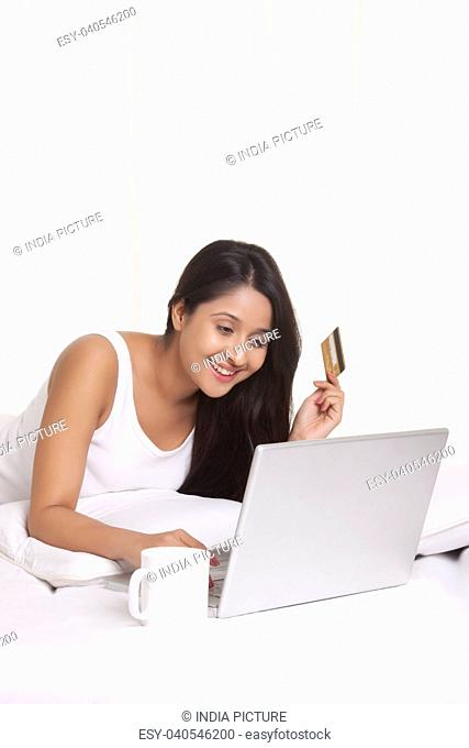 Young WOMEN using credit card